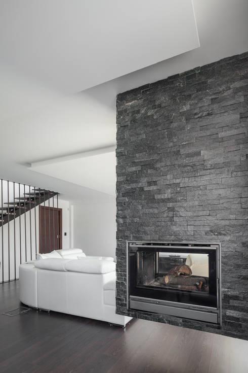 Living room by JPS Atelier - Arquitectura, Design e Engenharia