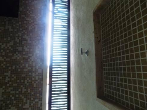 ventilacion de regadera: Baños de estilo  por bello diseño interior