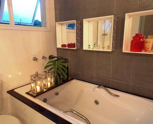 Banho suíte - banheira: Banheiros modernos por Lúcia Vale Interiores