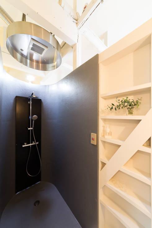 15坪の平屋のリフォーム: デザインプラネッツ一級建築士事務所が手掛けた浴室です。