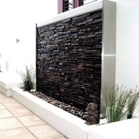 Texturas y Muros: Salas de estilo moderno por Arqpak