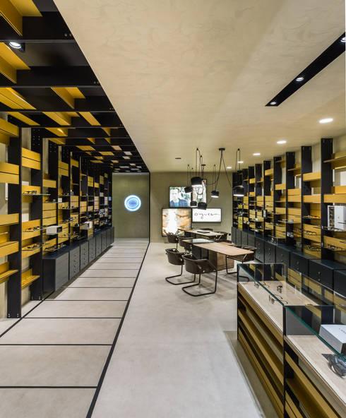 OMR_MTS2_6: Lojas e espaços comerciais  por XYZ Arquitectos Associados