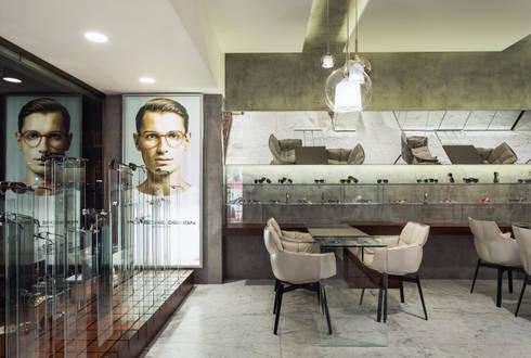 OM_1: Lojas e espaços comerciais  por XYZ Arquitectos Associados