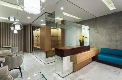 OM_8: Lojas e espaços comerciais  por XYZ Arquitectos Associados