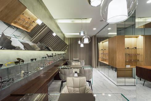 OM_9: Lojas e espaços comerciais  por XYZ Arquitectos Associados