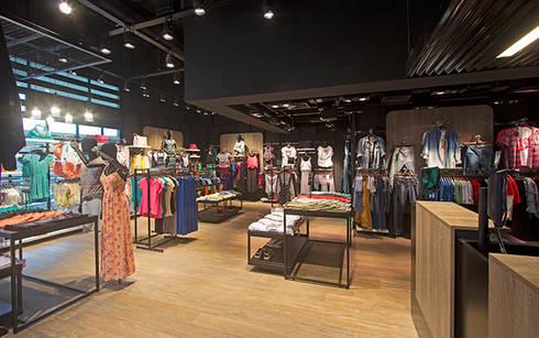 LOJA YOUCOM: Lojas e imóveis comerciais  por AMAC CONSTRUTORA