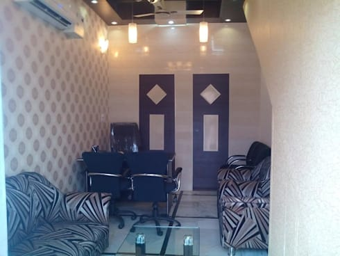 Ceiling and wall designing using pvc wall panels, wallpaper and led lights etc..: modern Study/office by Mohali Interiors