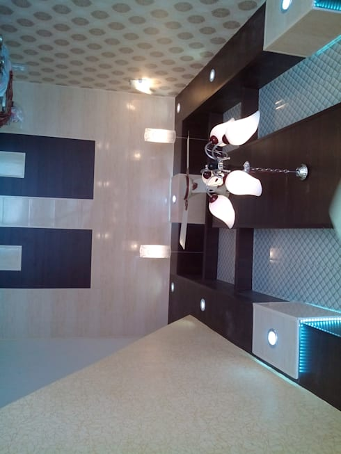 Ceiling and wall designing using pvc wall panels, wallpaper and led lights etc..:  Office spaces & stores  by Mohali Interiors