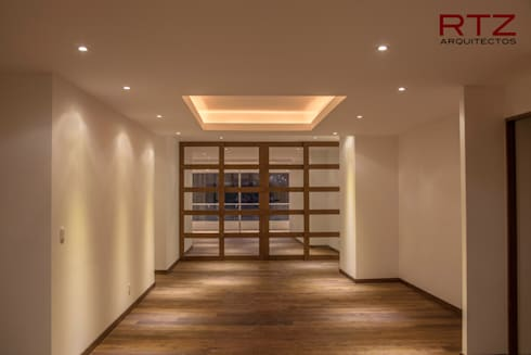 Puerta plegadiza para dividir cuartos: Paredes de estilo  por RTZ-Arquitectos