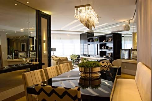 Projeto com toques masculinos para um jovem solteiro: Salas de jantar modernas por marli lima designer de interiores