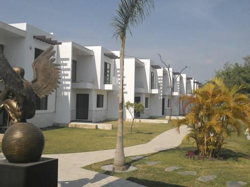 Bosques de Jiutepec: Casas unifamiliares de estilo  por D&E-ARQUITECTURA