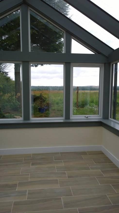 Grey Conservatory:  Conservatory by Architects Scotland Ltd