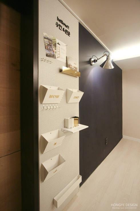 네 가족이 사는 심플모던스타일의 집_48py: 홍예디자인의  아이방