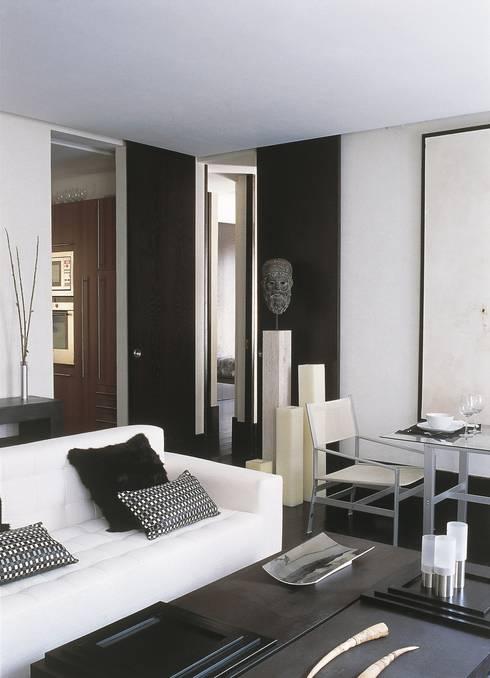 BOH: Salones de estilo  de MILLENIUM ARCHITECTURE