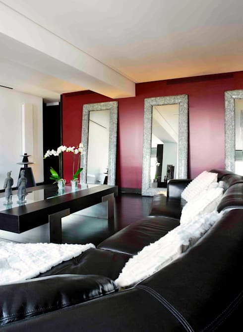 RIVIA: Salones de estilo  de MILLENIUM ARCHITECTURE