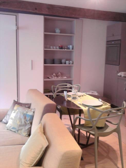 SAINT HONORE Paris 1er: Salle à manger de style de style Moderne par concepts d'interieurs