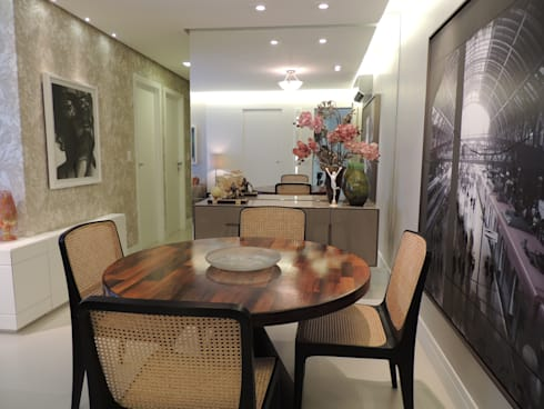 Um apartamento cheio de estilo: Sala de jantar  por CRAFT ARQUITETURA