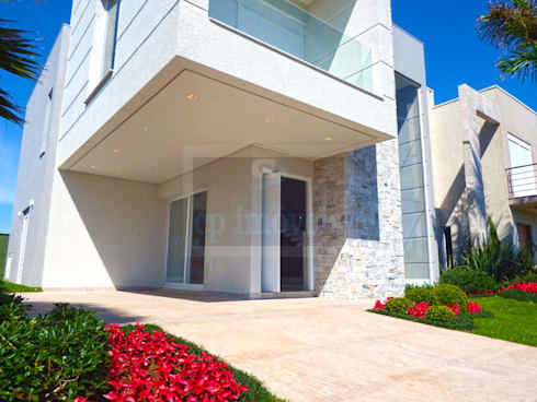 Casa J1: Casas minimalistas por Cipriani Arquitetura e Construção