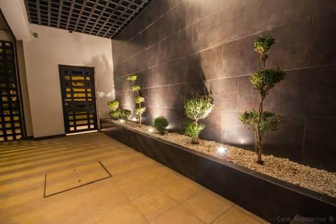 Casa AT: Pasillos y recibidores de estilo  por Cenit Arquitectos