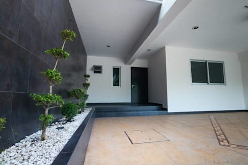 Casa AT: Garajes de estilo moderno por Cenit Arquitectos