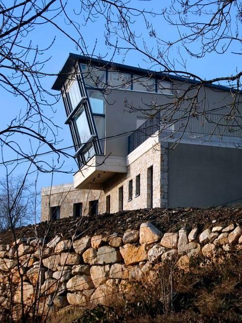 Maison individuelle: Maisons de style  par SARL DIDIER ALLIBERT
