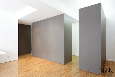 Vista da Sala para a Kitchenette: Salas de estar modernas por UMA Collective - Architecture