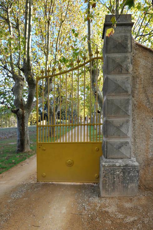 portail: Jardin de style  par goodnova godiniaux