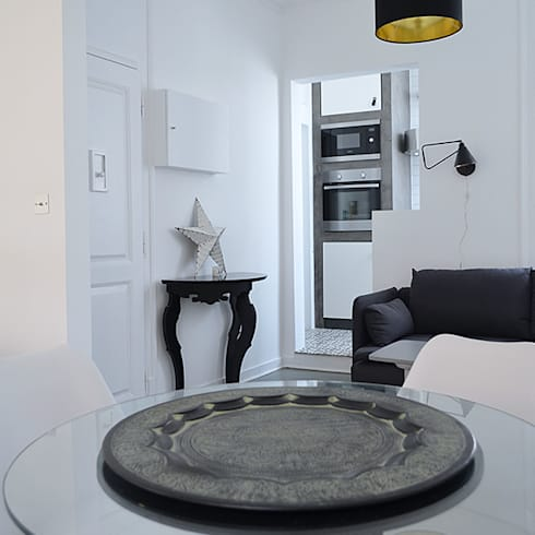 Recuperação de um apartamento: Hotéis  por Atelier Autêntico