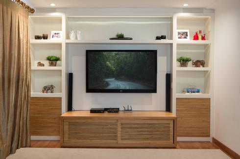 Apartamento VL: Salas multimídia modernas por Flavia Castellan Arquitetura