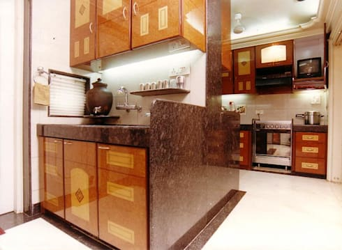 Apartment: modern Kitchen by NAMAN INTERIORS - Turnkey Interior Contractors