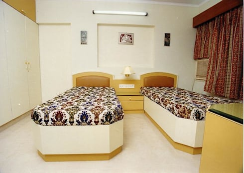 Apartment: modern Bedroom by NAMAN INTERIORS - Turnkey Interior Contractors