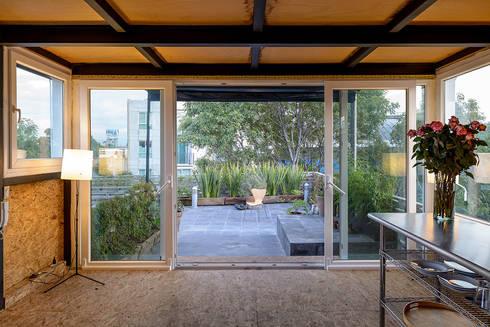 Sala: Salas de estilo moderno por Windlock - soluciones sustentables