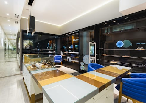 OMR_SM_6: Lojas e espaços comerciais  por XYZ Arquitectos Associados