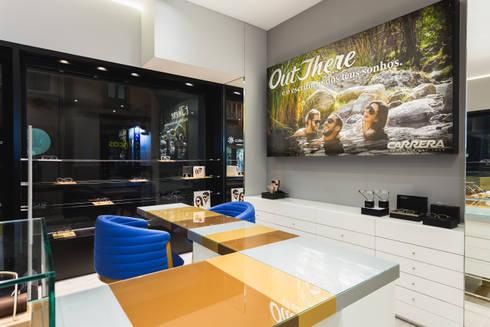 OMR_SM_8: Lojas e espaços comerciais  por XYZ Arquitectos Associados