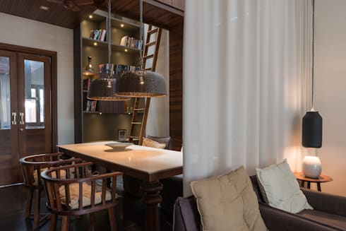 Dining_Under Atrium: modern Dining room by Design Plus
