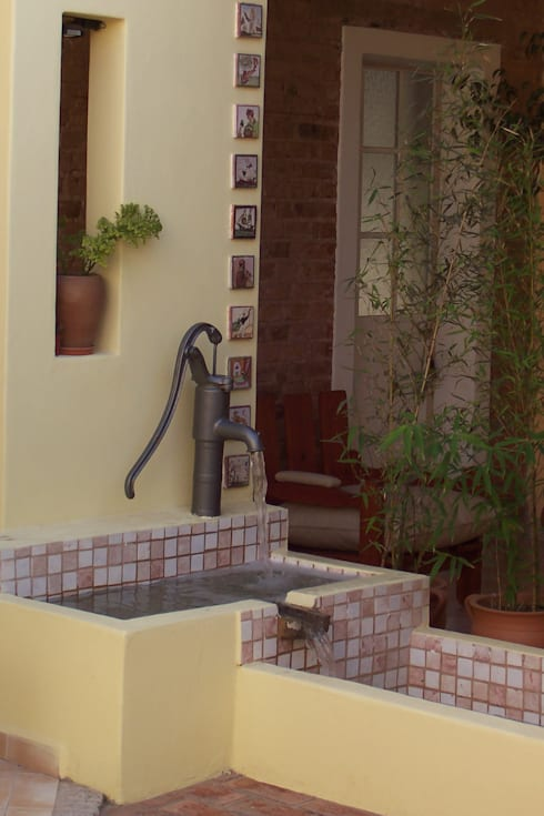 REMODELACIÓN COCINA - COMEDOR - PATIO DE LUZ: Jardines de estilo  por milena oitana
