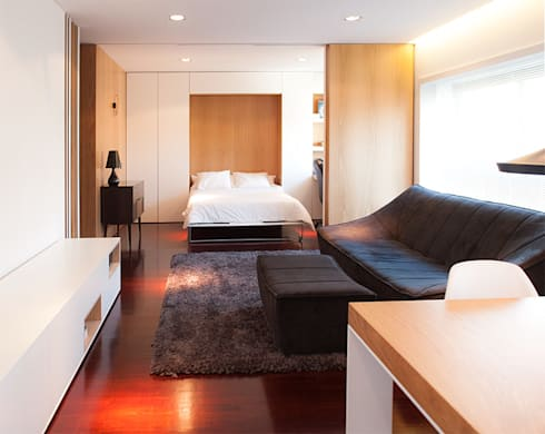 Reforma de apartamento: Salas de estar minimalistas por PAULO MARTINS ARQ&DESIGN