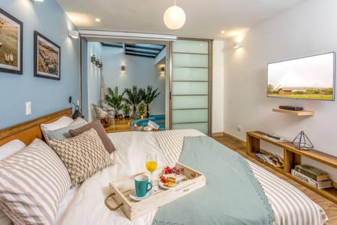habitación apto 101: Hoteles de estilo  por PLANTA BAJA ESTUDIO DE ARQUITECTURA