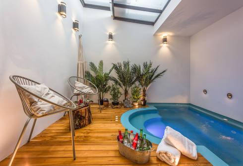 interior zona húmeda apto 101: Hoteles de estilo  por PLANTA BAJA ESTUDIO DE ARQUITECTURA