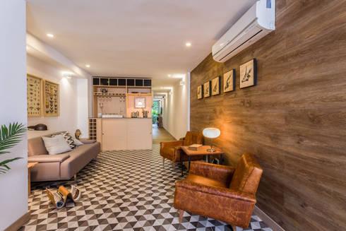 interior área social apto 102: Hoteles de estilo  por PLANTA BAJA ESTUDIO DE ARQUITECTURA