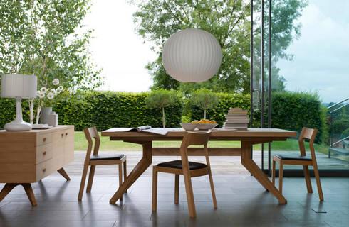 Mesa con extension y Credenza Cross & Silla Profile.: Comedor de estilo  por Design Within Reach Mexico