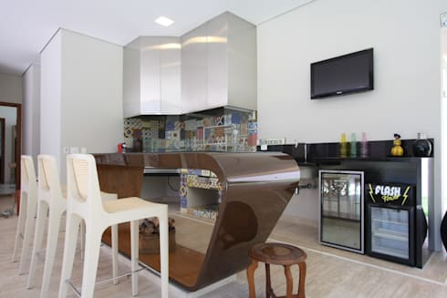 Interiores Residência Melville: Varanda, alpendre e terraço  por Officina44