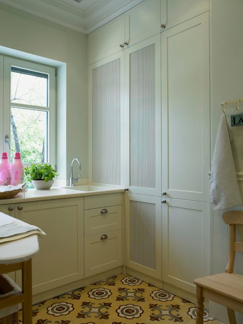 Lavadero y planchador: Cocinas de estilo  de DEULONDER arquitectura domestica