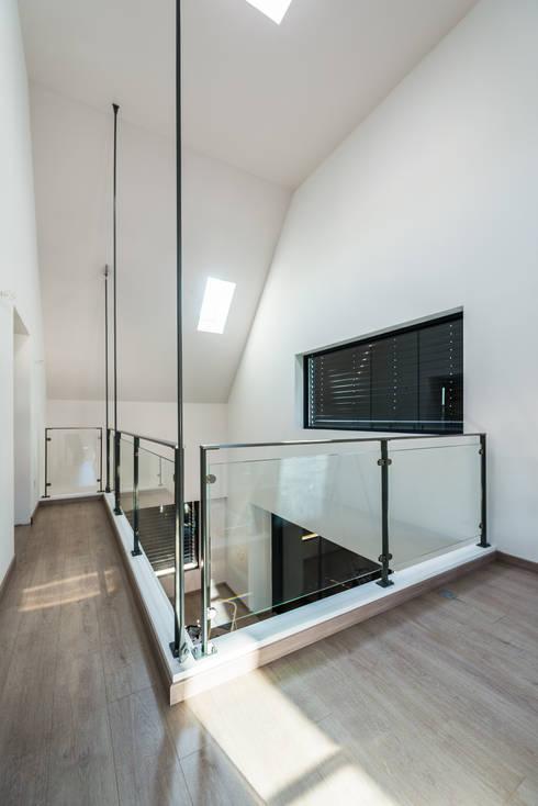 Mezzanine: Jardin d'hiver de style  par [ADitude*] Architecture
