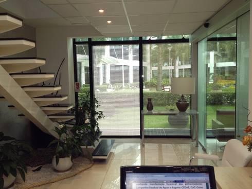 Sala da secretaria: Espaços comerciais  por Studio HG Arquitetura