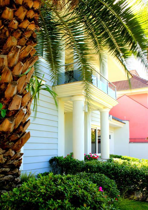 Projeto Arq. André Pacheco: Casas modernas por BRAESCHER FOTOGRAFIA