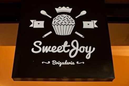 Sweet Joy Brigaderia: Espaços comerciais  por iS arquitetura