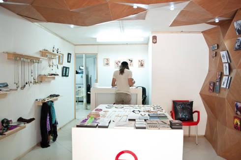 Tienda Encuadrarte : Oficinas y Tiendas de estilo  por somos2