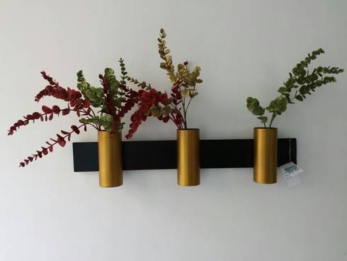 Sleek Cylinders:  Interior landscaping by Designmint