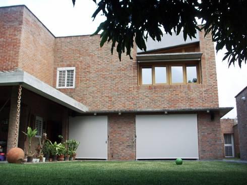 Kurumbo house: Casas de estilo  por Odart Graterol Arquitecto